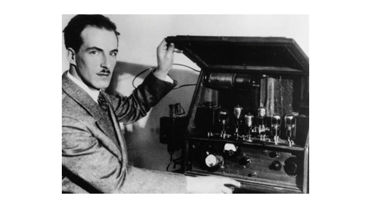 Leon Theremin with his invention