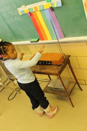 child playing theremin in class